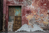 A Merchant Offers a Pair of Angel Wings for Sale on a Sidewalk in Mexico Photographic Print by Greg Davis