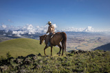 A Woman Rides the Range Above the Anderson Ranch to Deter Predators from the Cattle Photographic Print by Cory Richards