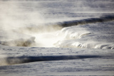 Steam Rises Off the Warm Water Flowing Through a Yellowstone Valley Photographic Print by Robbie George
