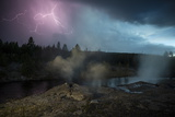 Lightning Strikes Above the Fan and Mortar Geysers in Yellowstone's Upper Geyser Basin Photographic Print by Michael Nichols