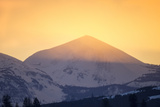 The Setting Sun Lends its Last Light to Illuminate Mountain Peaks Photographic Print by Robbie George