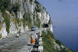 Near Trieste, Italy. Motorists Pass People on a Scenic Road Atop a Cliff Overlooking a Bay Photographic Print by B. Anthony Stewart