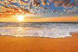 Colorful Ocean Beach Sunrise. Photographic Print by  vrstudio