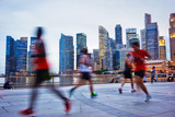 People Runing in the Evening in Singapore Photographic Print by  joyfull