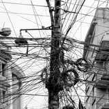 The Chaos of Cables and Wires in Kathmandu - Nepal (Black and White) Photographic Print by Vadim Petrakov