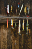 Fishing Lure Hanging on Wall, Sandham, Sweden Photographic Print by  BMJ