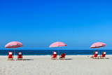 Three Sun Umbrellas at Santa Monica Beach Photographic Print by BlueOrange Studio