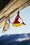 Rock Climber Bivouacked in His Portaledge on an Overhanging Cliff. Photographic Print by Greg Epperson