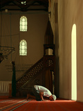 Young Muslim Man Praying in Mosque by the Window Photographic Print by Saida Shigapova