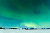 Intense Northern Lights or Aurora Borealis or Polar Lights on Moon Lit Night Sky over Winter Landsc Photographic Print by  Pi-Lens