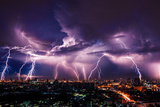 Lightning Storm over City in Purple Light Photographic Print by Vasin Lee