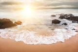 Glorious Sunrise Scene at the Ocean with the Sun, Clouds and a Beautiful Little White Wave on the S Photographic Print by  Smileus