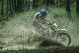 Motocross Driver under the Spray of Mud Photographic Print by  sportpoint