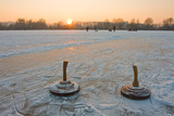 Two Bavarian Curling Stones on a Frozen Lake at Sunset Photographic Print by Bernd Juergens