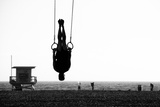 Silhouette of a Person Swinging on Rings on the Beach, Santa Monica Beach, Santa Monica, Los Angele Photographic Print by Celso Diniz