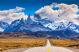 The Highway Crosses the Patagonia and Leads to Snow-Capped Peaks of Mount Fitzroy. over the Road Fl Photographic Print by  kavram