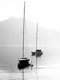 Two Sail Boats in Early Morning on the Mountain Lake. Black and White Photography. Salzkammergut, A Photographic Print by  Kletr
