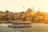 Tourist Boat Floats on the Golden Horn in Istanbul at Sunset, Turkey Photographic Print by Viacheslav Lopatin