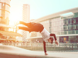 Extreme Parkour in Business Center. Young Boy Performing Some Jumps from Parkour Discipline Photographic Print by  Oneinchpunch