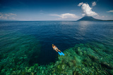 Young Lady Snorkeling over the Reef Wall in the Area of the Island of Bunaken, Sulawesi, Indonesia Photographic Print by Dudarev Mikhail