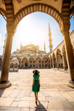 Young Woman Traveler in the Green Dress and Hat Walking to the Blue Mosque in Istanbul Photographic Print by  RossHelen