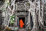 Monk in Angkor Wat Cambodia. Ta Prohm Khmer Ancient Buddhist Temple in Jungle Forest. Famous Landma Photographic Print by Banana Republic images