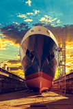 Ship in Dry Dock at Sunrise - Shipyard in Gdansk, Poland. Photographic Print by  Nightman1965