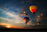 Colorful Hot Air Balloon is Flying at Sunrise Photographic Print by  rozbyshaka