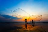 Fishermans in Action When Fishing at Sunrise, Wanon Niwat, Sakon Nakhon, Thailand. Photographic Print by  TWStock