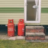 Gas Bottles by Caravan Photographic Print by Clive Nolan