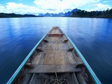 Long-tailed Boat on Chiaw-Lan Lake Photographic Print by Paul Edmondson