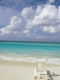 Lone Lounge Chair on Sandy Beach Photographic Print by Jack Hollingsworth