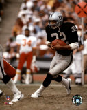 Marcus Allen - Black Uniform With Ball Photo