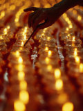 Hand Lighting Candles at Taoist Ceremony, Singapore, Singapore Photographic Print by Michael Coyne
