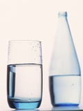 Bottle and glass of water Photographic Print