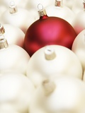 White Christmas tree decorations and a red one Photographic Print