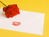 Envelope with lipstick kiss, red rose Photographic Print