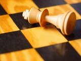 King chess piece lying on chessboard Photographic Print