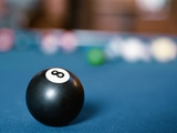 Eight ball on pool table Photographic Print
