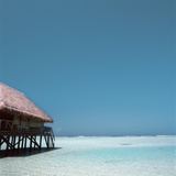 Beach Hut Over Shallow Water Photographic Print