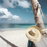 Straw Hat and Hammock at the Beach Photographic Print