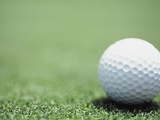 Golf Ball Sitting on the Green Photographic Print