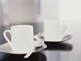 Two coffee cups on a table Photographic Print