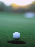 Golf Ball Close to Hole Photographic Print by Robert Llewellyn