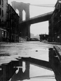 Puddle Reflecting Brooklyn Bridge Photographic Print by  Bettmann
