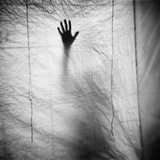 Shadow of a Hand Against Cloth Photographic Print by Annette Fournet