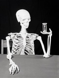 Skeleton Holding Hourglass Photographic Print by  Bettmann