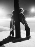 Teenagers Leaning on Utility Pole Photographic Print by  Bettmann