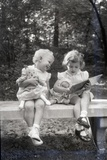 Two Little Girls Sitting on a Bench Photographic Print by Philip Gendreau