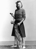 Woman Holding Golf Club and Golf Bag Photographic Print by Philip Gendreau